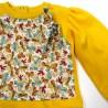 Détail du devant superposé en jersey imprimé noeuds multicolores bébé fille