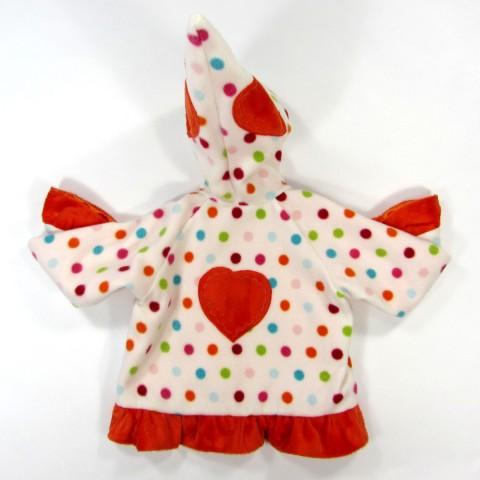 Dos du manteau gros coeur dans le dos volant en fourrure synthétique orange à la base du vêtement
