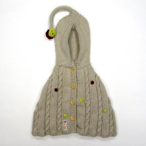 Poncho beige en grosse laine avec torsades pour bébé fille